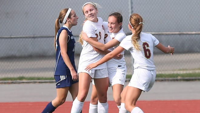 Arlington's Meggie Buttinger (2) is greeted by teammates after scoring a first half goal against Suffern during the girls soccer Section 1 Class AA  championship game at Yorktown High School Oct. 30, 2016. Arlington won the game 2-0.
