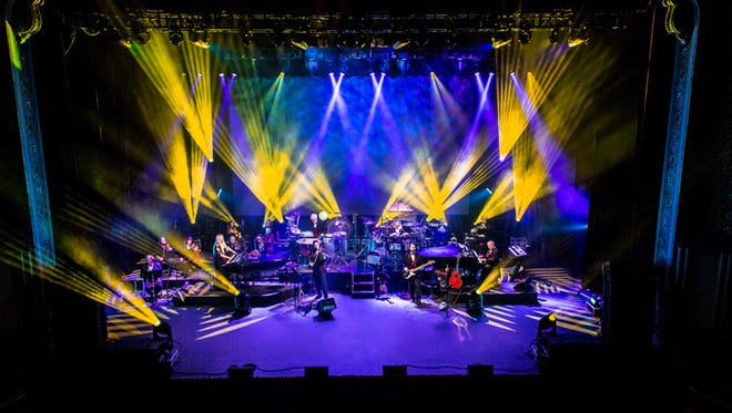 Special lighting effects accompany Mannheim Steamroller's 18th-century neoclassical electric holiday music.