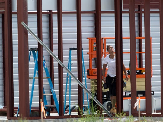Construction crews work on a new storage facility near the corner of Goodlette-Frank Road and Ridge Street Thursday, June 8, 2017, in Naples.