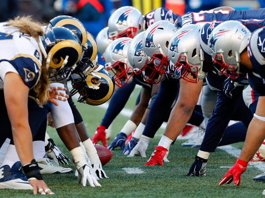 Dec 4, 2016; Foxborough, MA, USA;  The New England Patriots and the Los Angeles Rams line up for the snap at the line of scrimmage during the second half of the New England Patriots 26-10 win over the Los Angeles Rams  half at Gillette Stadium. Mandatory Credit: Winslow Townson-USA TODAY Sports