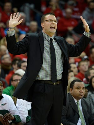 UW-Green Bay head coach Brian Wardle shouts instructions to his players during Wednesday night's game against Wisconsin at the Kohl Center in Madison. Evan Siegle/Press-Gazette Media