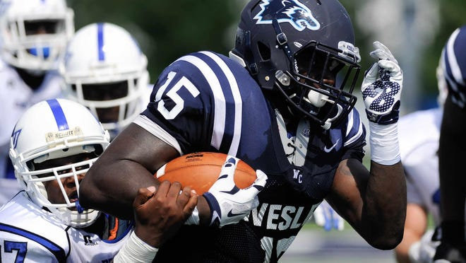 Wesley's #15 Kyle George runs the ball in the first quarter against Christopher Newport University.
