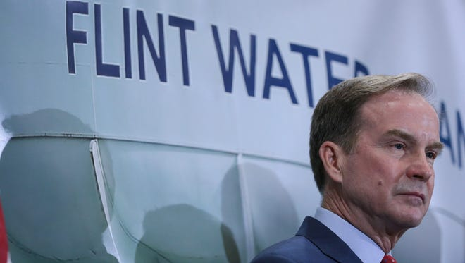 Attorney General Bill Schuette announces new charges against two high-ranking state health officials in the fourth round of criminal charges in the Flint drinking water crisis on Wednesday June 14, 2017 during a press conference at Riverfront Banquet Center in downtown Flint.