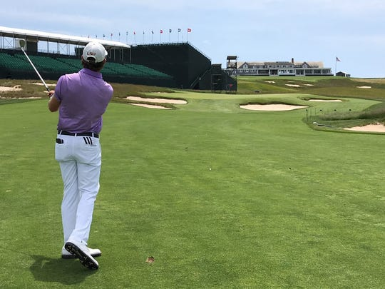 Philip Barbaree Jr. plays an approach shot to the 16th