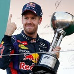 Red Bull driver Sebastian Vettel of Germany celebrates after winning the Japanese Formula One Grand Prix at the Suzuka circuit in Suzuka, Japan.