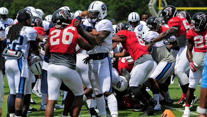 Titans and Falcons players brawl during a special teams drill at the start of their joint practice on Monday in Flowery Branch, Ga.
