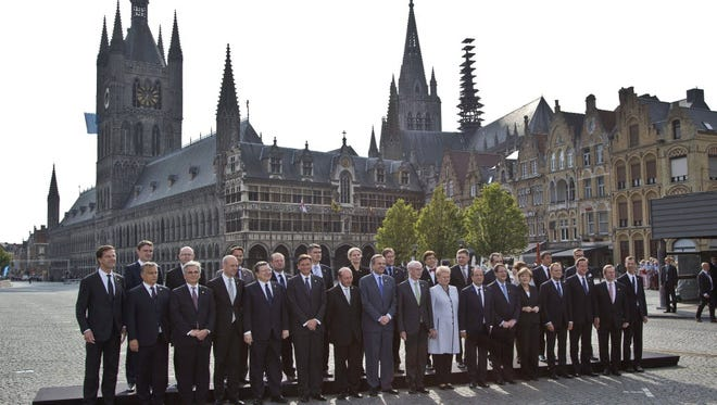 European Union heads of state pose for a group photo in front of the Cloth Hall during an EU summit in Ypres, Belgium on June 26.
