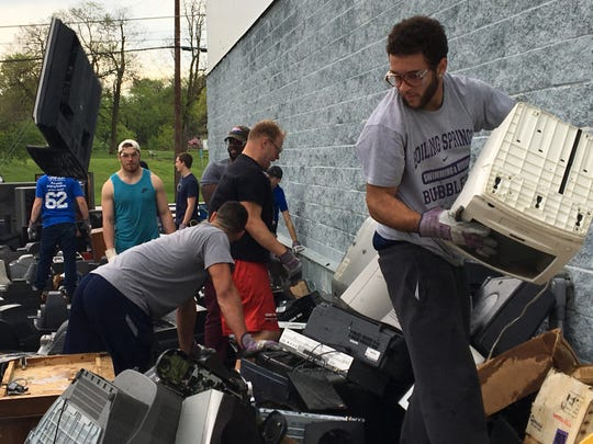 Jailen Harmon, right, and other members of the Red Raider football team help sort electronics collected during Ship Shape Day in 2017.
