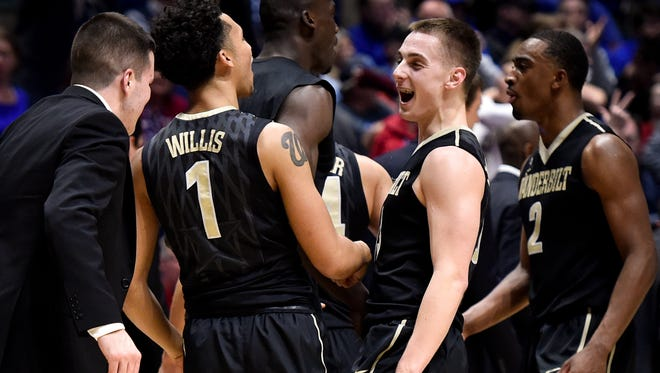 Vanderbilt Commodores guard Payton Willis (1) and guard Riley LaChance (13) react after they defeated Florida in a 2017 SEC Men's Basketball Tournament game at Bridgestone Arena Friday, March 10, 2017 in Nashville, Tenn.