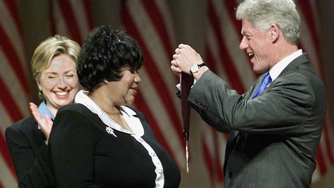 President Bill Clinton along with First Lady Hillary Rodham Clinton award singer Aretha Franklin with the 1999 National Medal of Arts and Humanities Award in Sept. 1999 in Washington, DC.