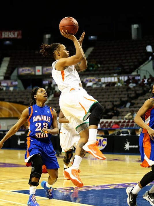 Jasmine Grice drives to the basket.jpg