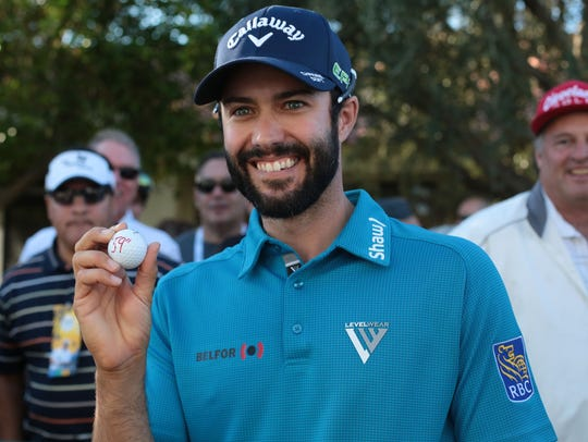 Adam Hadwin poses with his ball at the La Quinta Country