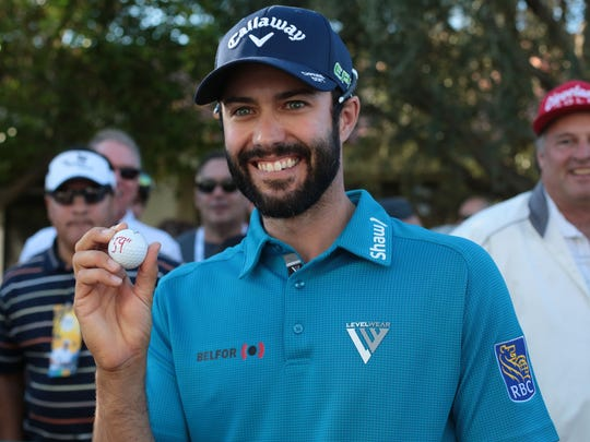 Adam Hadwin poses with his ball at the La Quinta Country Club  during the 3rd round of the CareerBuilder Challenge on Saturday, January 21, 2017. He finished the day at 17 under.