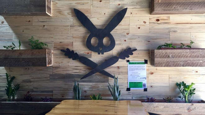 The coat of arms of the DeLuxe, a rabbit with crossed carrots, marks the approach to the new restaurant in downtown Reno's West Street Market.