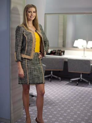 FILE - In this March 6, 2015 file photo, Ivanka Trump models an outfit following an interview to promote her clothing line in Toronto. Nordstrom said Thursday, Feb. 2, 2017,  it will stop selling Ivanka Trump clothing and accessories. The Seattle-based department store chain said the decision was based on the sales performance of the first daughter's brand.