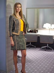 FILE - In this March 6, 2015, file photo, Ivanka Trump models an outfit following an interview to promote her clothing line in Toronto. As the first daughter crafts a new political career from her West Wing office, her brand is going strong, despite boycotts and several stores limiting her merchandise.