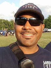 Lansing firefighter Michael Lynn, pictured here, is suing the city for racial discrimination.