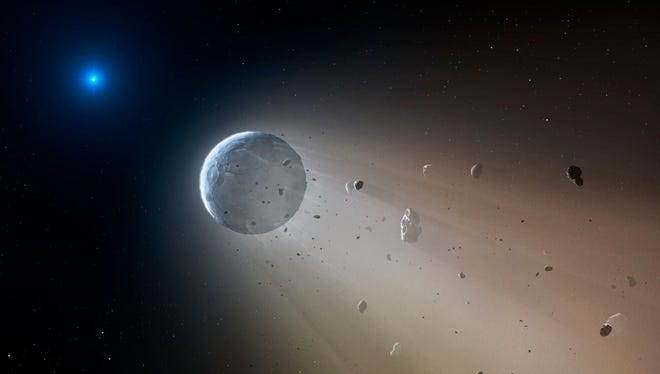 """An artistic representation of a white dwarf star that appears to be """"cannibalizing"""" a miniature planet."""
