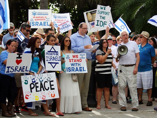 """Israel supporters take part in a solidarity rally Sunday at Naples Pier. More than 200 people attended the rally which was hosted by the group, """"Stand With Israel / Naples."""""""