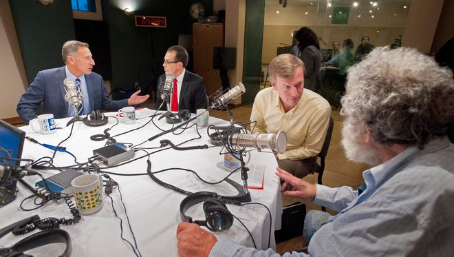 Gov. Peter Shumlin, left, chats with Libertarian Dan Feliciano as Republican Scott Milne speaks with Peter Diamondstone, right, of the Liberty Union party before a debate between gubernatorial candidates hosted by Vermont Public Radio at their studios in Colchester on Tuesday.