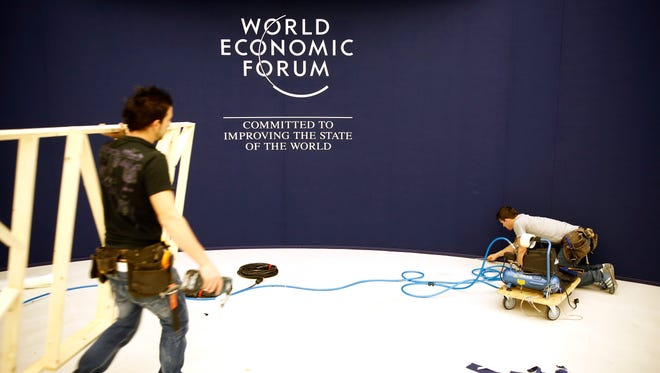 Workers prepare a section of the floor inside the Congress Center ahead of the World Economic Forum's annual meeting in Davos, Switzerland.