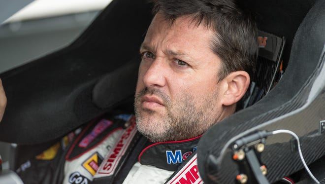 Race car driver Tony Stewart, shown here in a file photo from qualifying for the Duck Commander 500 at Texas Motor Speedway in April, is well-known in his hometown of Columbus, Ind., a city of more than 45,000 residents where Stewart still lives.