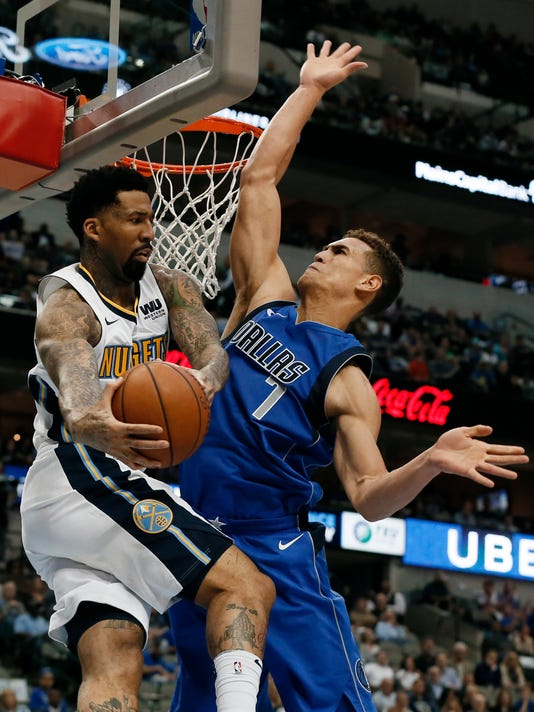 Denver Nuggets forward Wilson Chandler (21) is forced to pass the ball out as Dallas Mavericks' Dwight Powell (7) defends beneath the basket in the first half of an NBA basketball game, Monday, Dec. 4, 2017, in Dallas. (AP Photo/Tony Gutierrez)