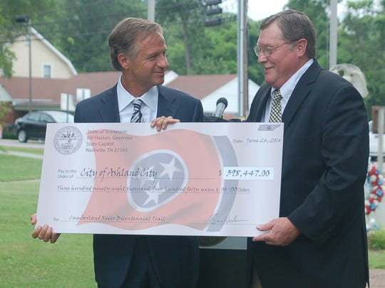 Tennessee Gov. Bill Haslam (left) presents a check for $398,447 to Ashland City mayor Rick Johnson.