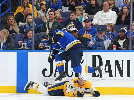 St. Louis Blues right wing Scottie Upshall (9) jumps