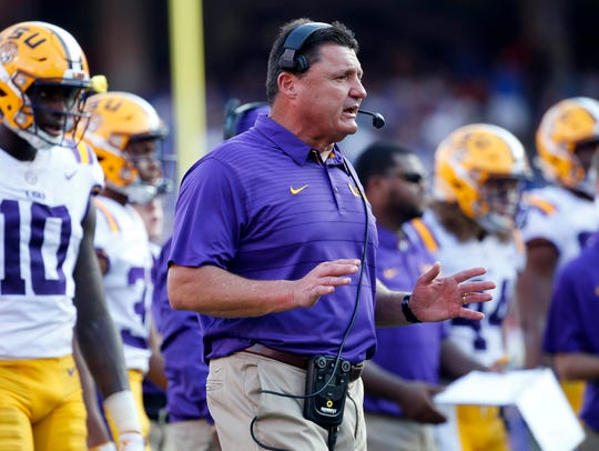 LSU coach Ed Orgeron reacts on the sidelines during