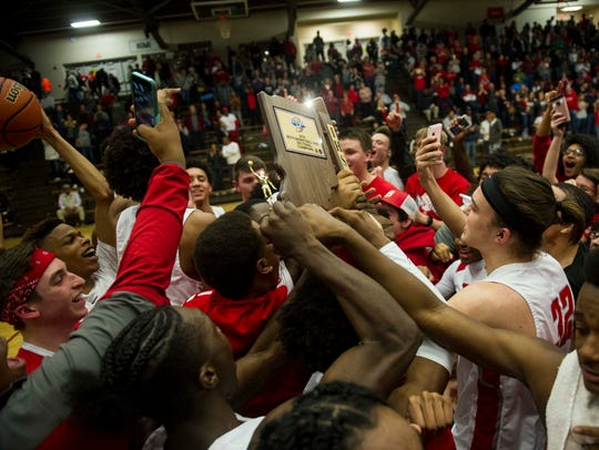 Bosse's team and fans collide on the court after defeating