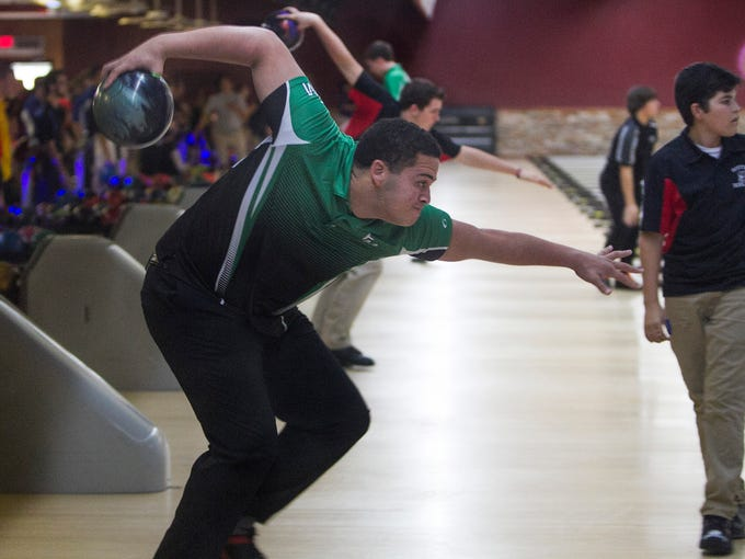 Fort Myers High School bowler Port Lewis aims for the