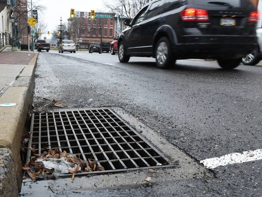 A storm drain is seen on Lincoln Way East near the Chambersburg Square on Friday, January 20, 2017. Municipalities want Congressman Bill Shuster to to repeal the storm water rules, which they say are expensive and a dubious value to the Chesapeake Bay cleanup.