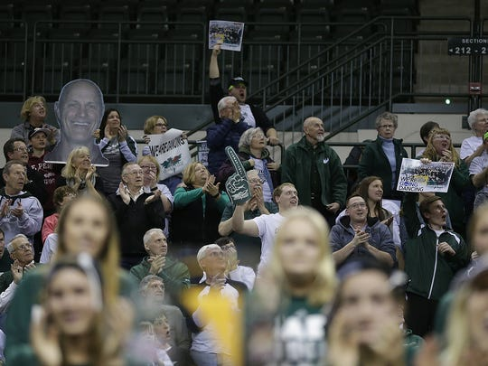 Fans cheer on the UWGB women's basketball team during