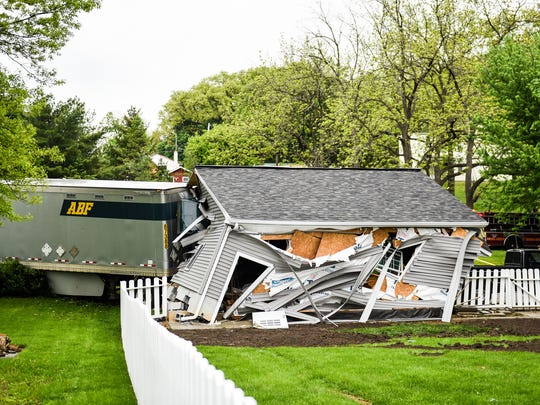 A tractor trailer drive by Robert MacDonald of Perkiomenville, PA  crashed into a garage after it ran a stop sign and collided with a Toyota Corolla driven by Amy Krick of Lebanon at the intersection of N. 24th St. and Union Canal Drive on Thursday, May 11, 2017, according to police. MacDonald who was transported to the Hershey Medical Center. The garage, owned by, Ryan Winters, had two Mustangs stored in it that were damaged. The garage collapsed when the tractor trailer was removed.