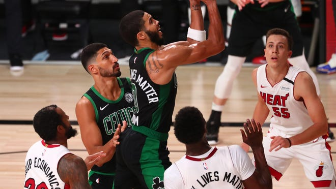 Boston's Jayson Tatum drives to the basket against the Miami Heat in Game 5 of the Eastern Conference finals on Friday night.