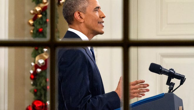 President Barack Obama addresses the nation from the Oval Office at the White House on Dec. 6.  The president's speech followed the Dec. 2 shooting in San Bernardino, California.