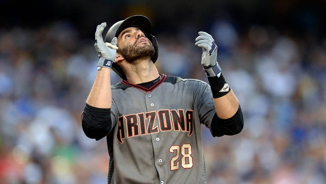 J.D. Martinez celebrates his home run in the seventh inning.