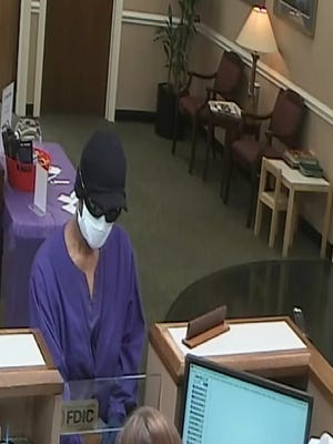 Police are investigating after a woman in scrubs and a surgical mask robbed the United Community Bank in Mauldin.