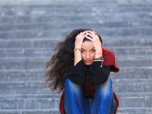 sad-woman-stairs