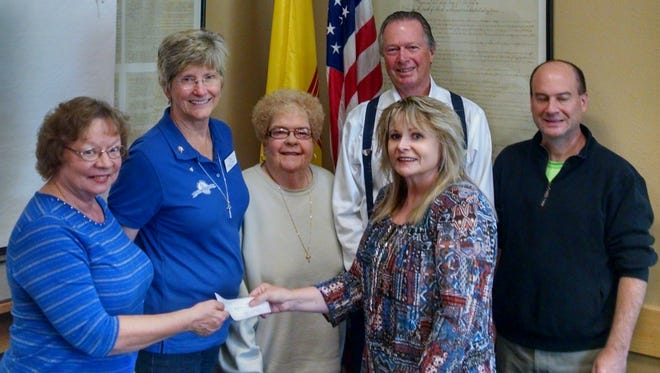 (Left to right) Altrusans Judy Griffin and MJ Thomas; LCAL Board Members K'Aun Kingsley, Dave Tomlin and Corey Bard; in front, receiving check, Adult Literacy Coordinator Robin Gilton.