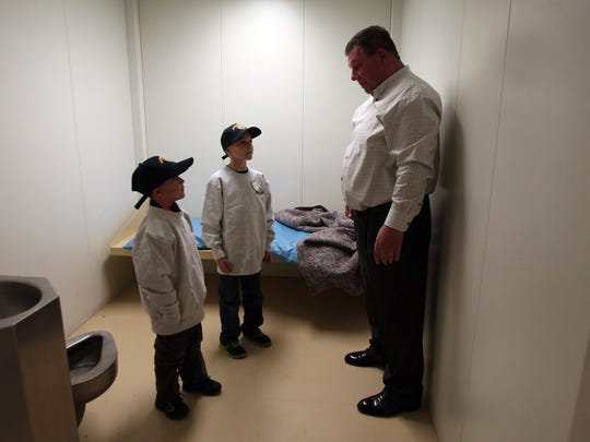 Roxbury Police Chief James Simonetti talks with Thomas and James  DeChristofano of Roxbury in a holding cell during a tour of the police station. The two siblings won a chance to ride with Roxbury police and pulling over two Detectives, issuing them a warning for not wearing a seatbelt. December 16, 2015, Roxbury, NJ.