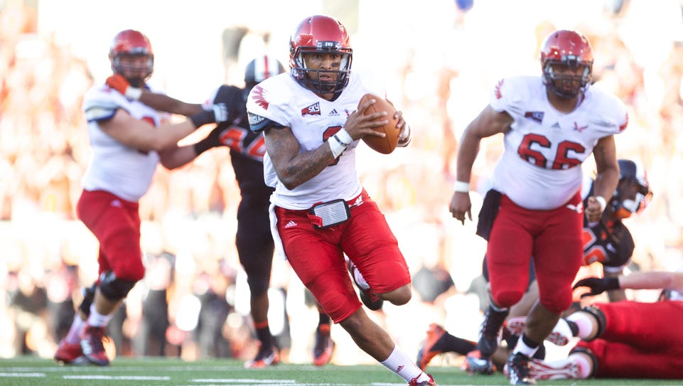 Vernon Adams accounted for six touchdowns in Eastern