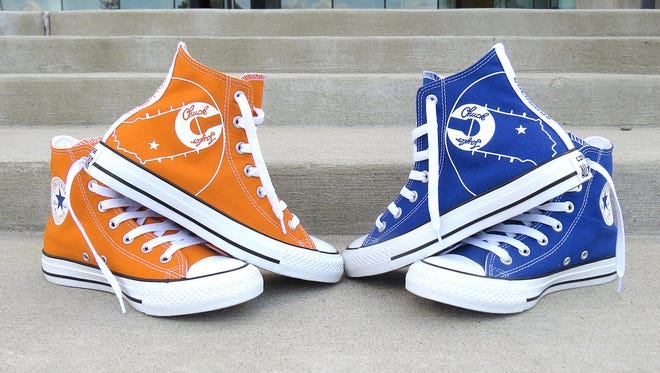 A limited-edition style of Chuck Taylor Converse All Star basketball shoes will come in royal blue and the other in orange, the colors for Columbus North and Columbus East.