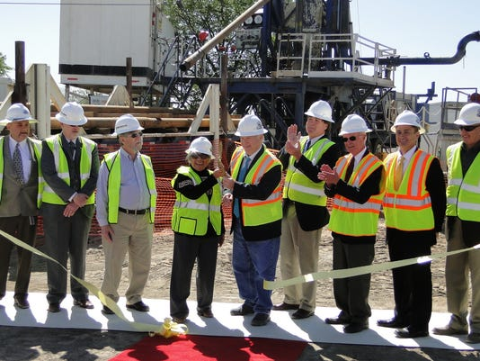 Utilities-Connection-Well-32-ribbon-Cutting.jpg