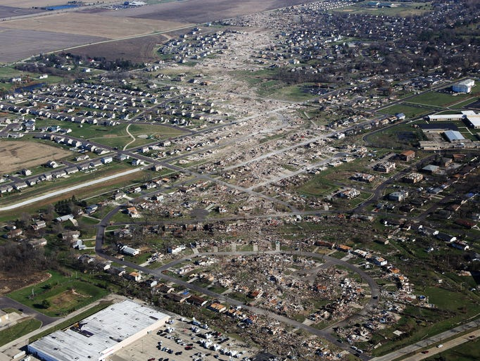 WASHINGTON, IL - NOVEMBER 18:  Tornado damaged homes are seen on November 18, 2013 in Washington, Illinois. According to reports the tonado that ripped across Washington, Illinois has been preliminary classified as an EF-4. A fast-moving storm system that spawned multiple tornadoes which touched down across the Midwest, leaving behind a path of destruction in 12 states and killing at least five.  (Photo by Tasos Katopodis/Getty Images) *** BESTPIX ***