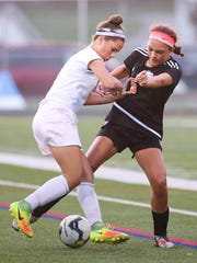 Central York's Torri Bailey (5) and Fairfield's Annabel