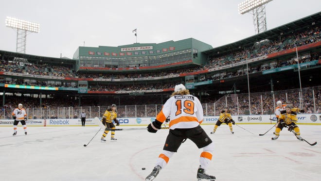 Philadelphia Flyers left wing Scott Hartnell (19) looks to make a pass against the Boston Bruins during the 2010 New Year's Day Winter Classic at Fenway Park in Boston. The Nashville Predators have had discussions about hosting a future outdoor hockey game.