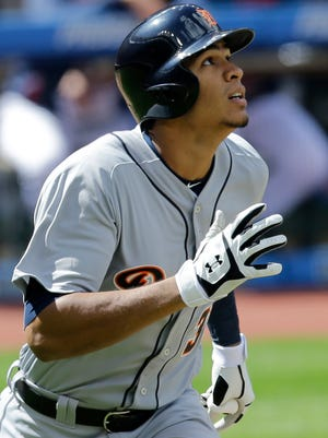 Tigers leftfielder Steven Moya watches his ball after hitting a triple off in the fourth inning Sunday in Cleveland.