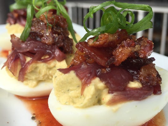 Classic deviled eggs with a three-onion marmalade and
